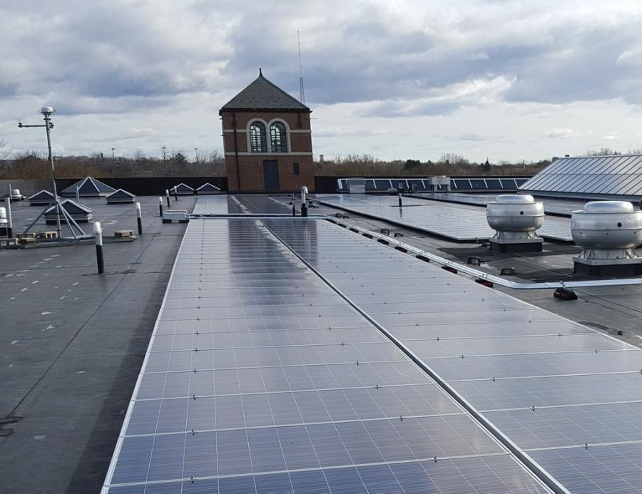Solar panels and air ducts on rooftop