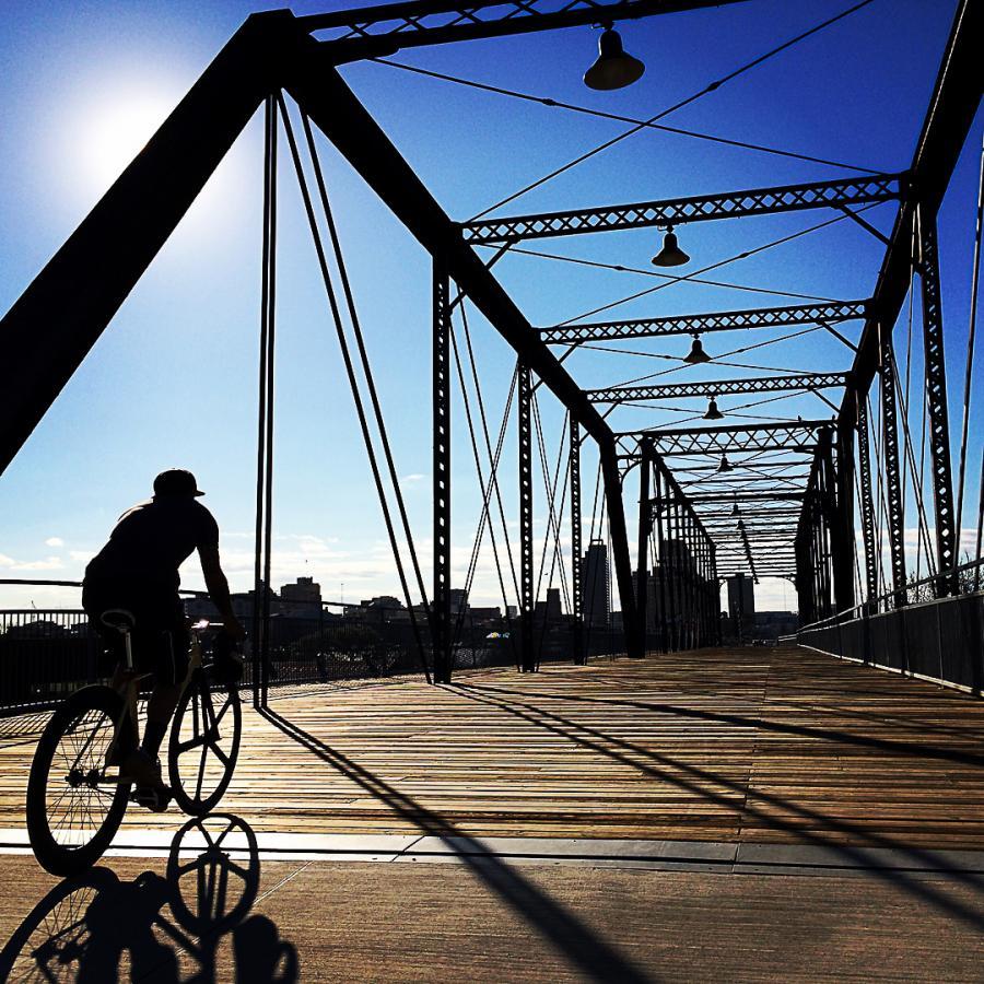 person biking on bridge